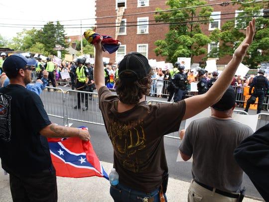 Protestor Will McMahan yells at counter-protestors