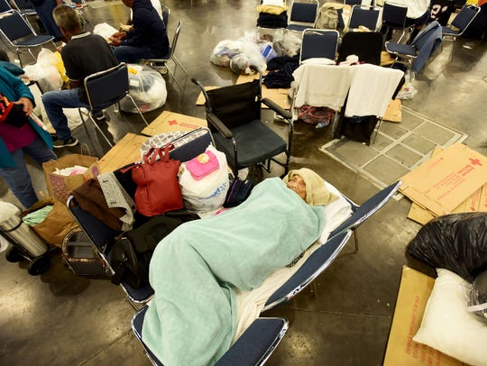 Ninety eight year old Yuth Chhut (cq) sleeps on chairs