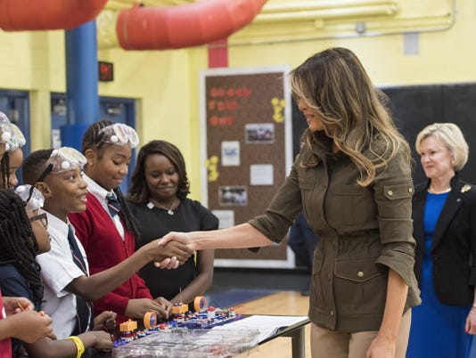 First lady shakes hands with boy