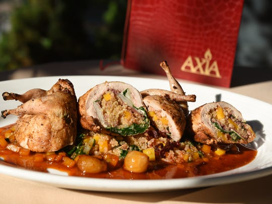 Quail with quinoa and butternut squash at Axia Taverna in Tenafly on Thursday September 28, 2017.