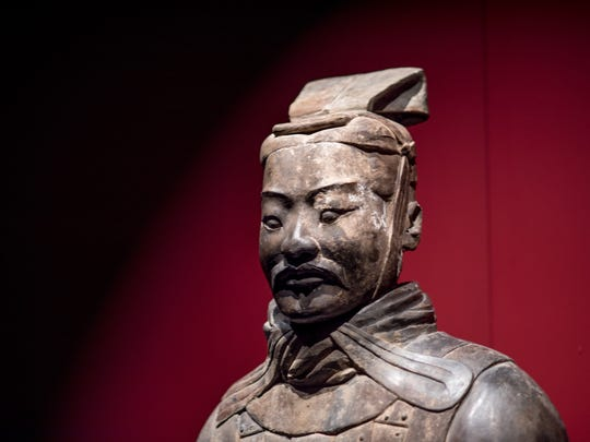 A close-up of the detailed face of one terracotta warrior.
