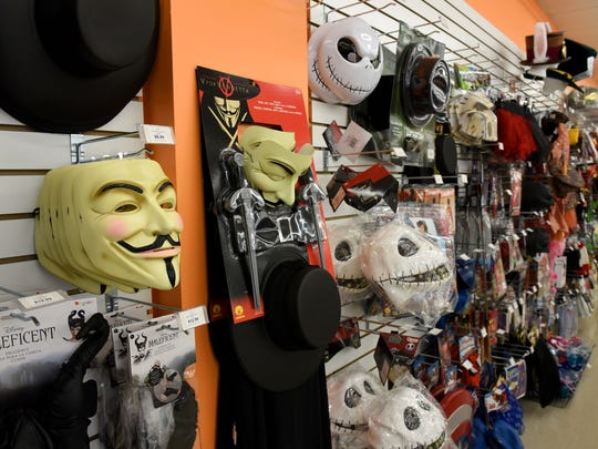 Costumes and masks at Halloween Corner Costumes & Accessories on Washington Pike at Washington Market shopping center Tuesday, Oct. 3, 2017.