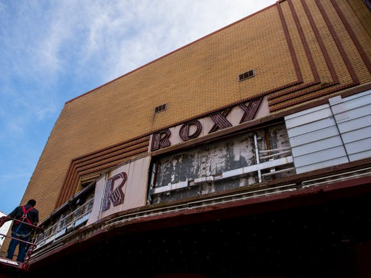 The original 1947 Roxy marquee being removed in preparation