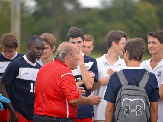 Worcester Prep coach Terry Underkoffler speaks with his team following a game.