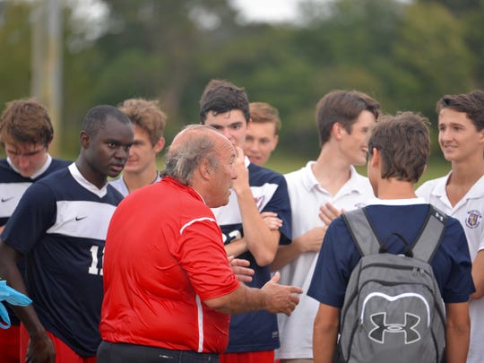 Worcester Prep coach Terry Underkoffler speak with his team following a game.