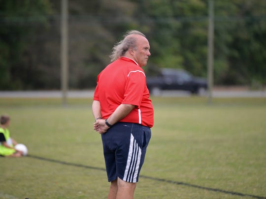 Coach Terry Underkoffler watches his team during a Worcester Prep boys' soccer team.