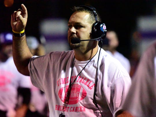 Fremont Ross coach Chad Long encourages his players to occupy their positions with discipline and refuse to lose.