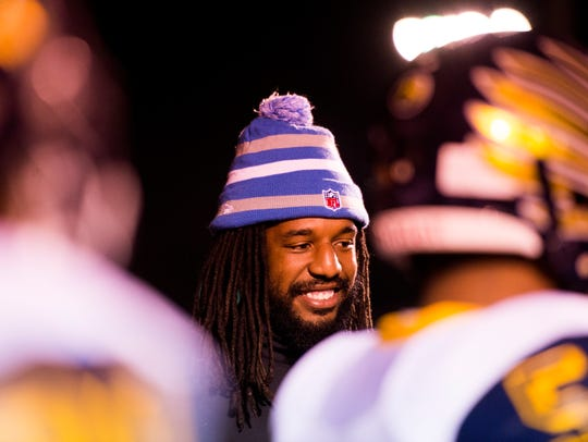 Jalen Reeves-Maybin visits with Northeast players before