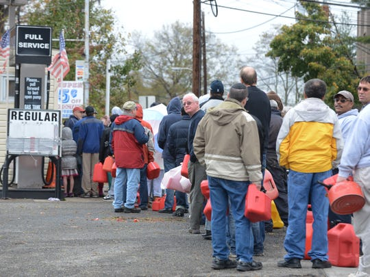 People line up to buy gas at a Delta gas station in Teaneck, Oct. 30, 2012.