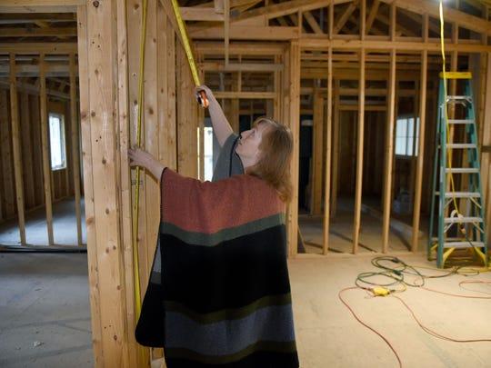 Lisa McCarter checks a measurement on her family's