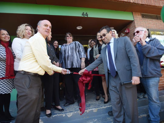 Mitch Schonfeld, left, CEO of Bergen Family Center, and Englewood Schools Superintendent Robert Kravitz cut the ribbon Monday to mark the opening of new classrooms for preschool students.