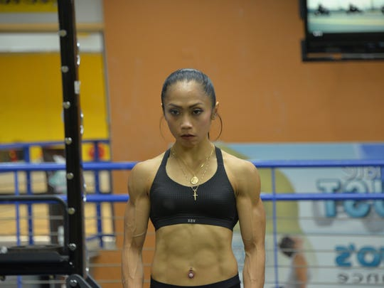 Rhea Macaluso does a variety of weight training exercises to stay ready for competition.