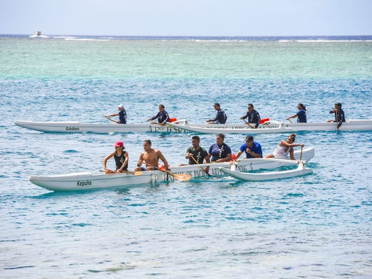 Paddlers participate in the paddling competition off the Malesso Pier on Saturday, Nov. 4, 2017. The southern village of Malesso is hosting its 50th annual Malesso Fiestan Tasi, or Water Festival, with a spearfishing contest, watercraft racing and other competitions schedule to be held on Sunday, Nov. 5.