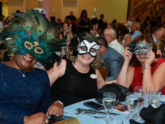 Highwayman Artist Doretha Hair-Truesdell, Fort Pierce Woman's Club President Jerry Dodson-Keodyker and SLC County Commissioner Linda Bartz wore gorgeous masks.