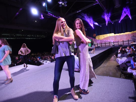 Lily Valiulis and Audrey Bergeron take a turn on the ramp at Loyola College Prep Style Show and Luncheon.
