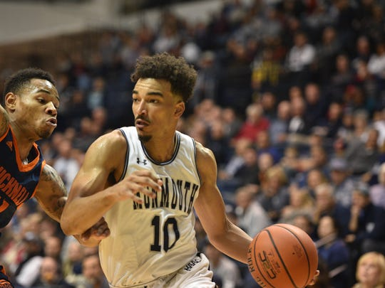 Monmouth's Micah Seaborn drives to the basket against Bucknell on Friday night.