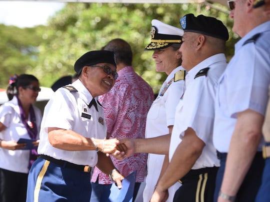 U.S. Army retired Master Sgt. Victoria Laganse is congratulated by Brig. Gen. Roderick Leon Guerrero, Guam National Guard Adjutant General after being recognized as one of the 2017 Veterans of the Year during the Veterans Day ceremony at Ypao Beach Park in Tumon on Saturday, Nov. 11, 2017.