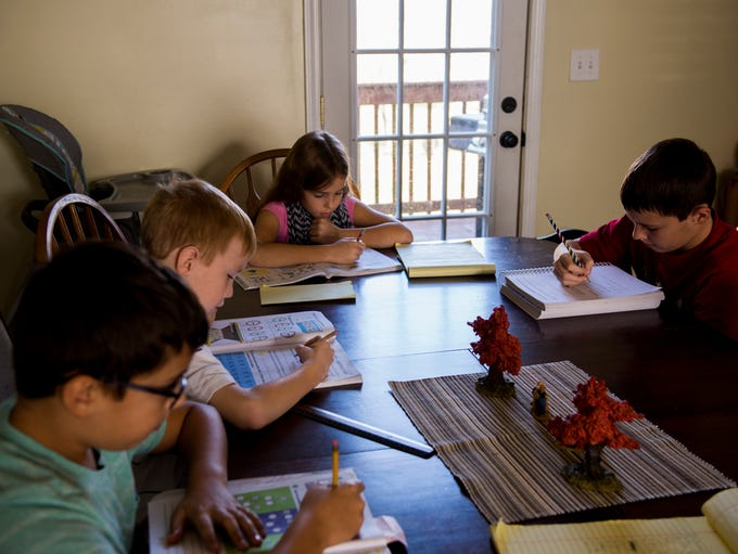 From left, Bennett, 10, Russell, 7, Camille, 9, and