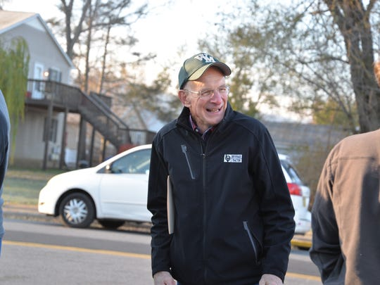 Kent Iberg waits in line for  the 30th annual Thanksgiving