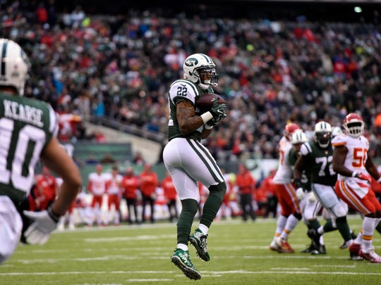 New York Jets running back Matt Forte (22) completes a pass for a touchdown in the first half. Kansas City Chiefs at the New York Jets in East Rutherford, NJ on Sunday, December 3, 2017.