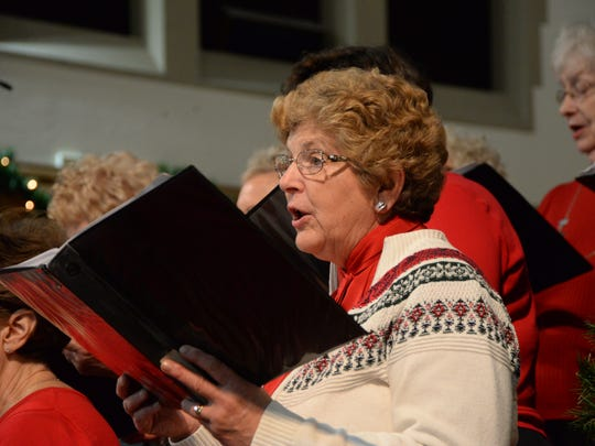 Members of the First Presbyterian Church choir sing during a night of Christmas music at Asbury United Methodist Church in York.