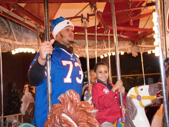 Dion Dawkins takes a spin on the merry-go-round during