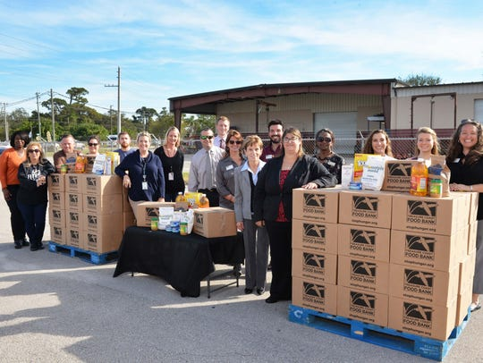 Treasure Coast Food Bank's annual Convoy of Hope rolled out Dec. 14, carrying 2,500 boxes of nutritious food for area seniors who struggle with hunger. Volunteers pictured here with some of the boxes are, from left, Theresa Baxter, Dilley Nerios, Gary Porter, Samantha Cruz, Bill Morris, Jennifer Harris, Angela Roberson, Clint Sperber, Travis Thompson, Triana Romero, Mary Craig, Homer Gutierrez, Krista Garafalo, Eve Jennings, Paige Shortsleeves, Meg Buckley, and Rebecca Rodriguez.