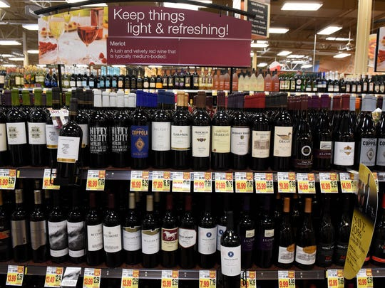 Cedar Bluff Kroger Marketplace wine selection Thursday, Dec. 21, 2017. Kevin Valley is the wine steward for the store and offers help to shopping customer.
