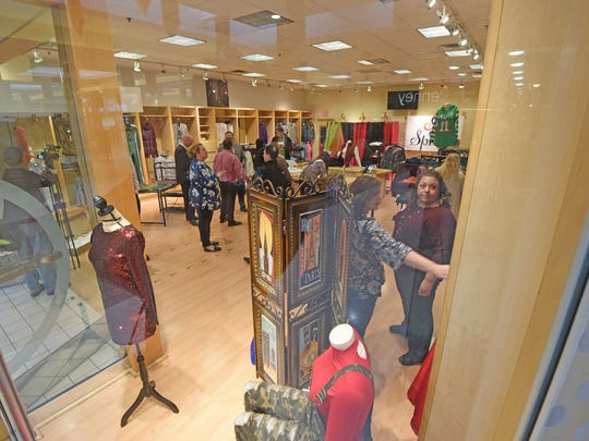 Visitors check out the fashions in the Spazz Clothing Boutique as it officially opened on Friday in the Richland Mall.