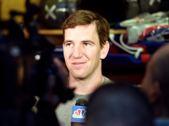 New York Giants quarterback Eli Manning talks to media
