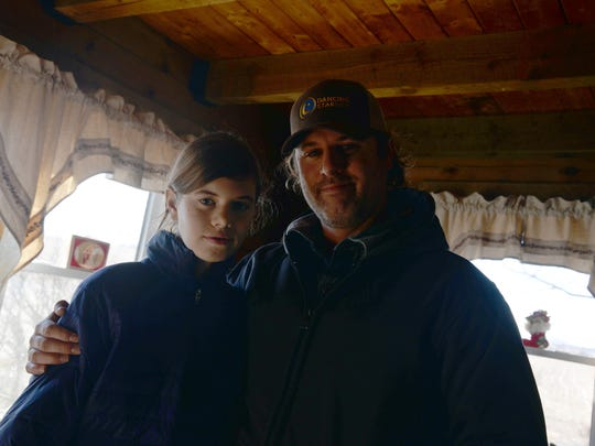 Ryan Blosser with his daughter Kai Marley at their home outside of Churchville on Jan. 5, 2018.