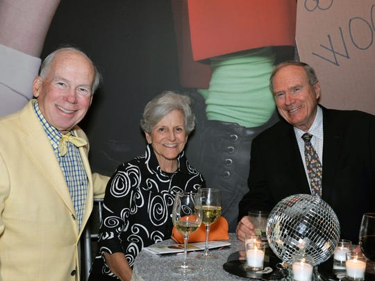 "Tom and Carol Frazier, left, and Mike Hoben at the Vero Beach Museum of Art's ""Rock of Ages"" gala."
