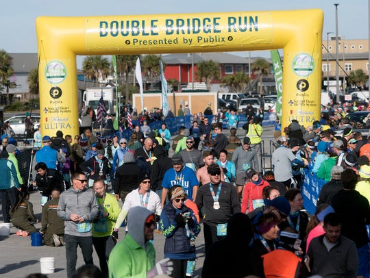 Runners make their way to the finish line during last year's Pensacola Double Bridge Run.