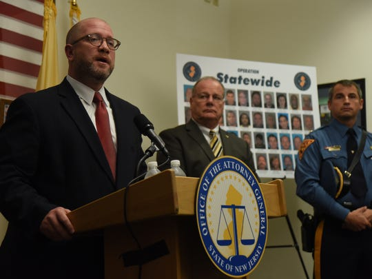 00021584A --  Hamilton, New Jersey  --  August 18,   2016  --- At the State Police Technology Center NJ Attorney General Christopher Porrino announced the arrest of 40 men from each county in New Jersey, on charges of possession and distribution of child pornography. Here is Porrino with State Police Superintendent Col. Rick Fuentes and State Police Lt. John Pizzuro, one of the members of law enforcement  involved in the investigation.   --  CHRIS PEDOTA / THE RECORD
