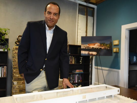 Michael Boulware Moore, President and CEO of the International African American Museum stands in front of a model of the International African American Museum which will be built on the site where Gasden's Wharf once stood in Charleston, SC. The museum plans to break ground on this site some time this summer.