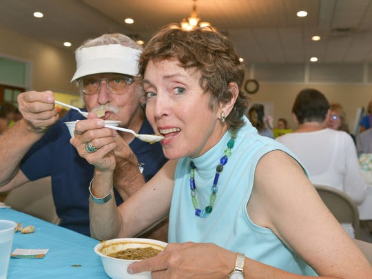 David and Susan Opasik each enjoy a bowl of soup at the Empty Bowls project. Named after local ceramic artist Lundin Kudo, the event is now in its 12th year.