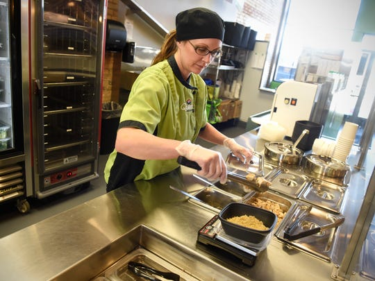 Lisa Schulte prepares an order with fresh ingredients