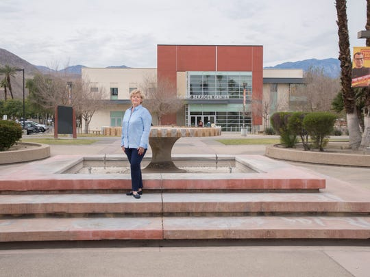 "Eastes, standing in front of COD's fountain in 2017, said she is ""honored to be part of history,"" which includes the 41 years she spent working at the college bookstore."