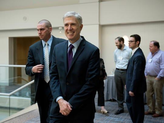Supreme Court Associate Justice Neil Gorsuch leaves