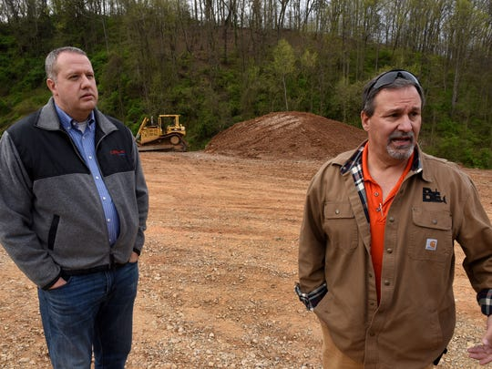 Steve Garner, right, with Blount Excaviting, and his engineer Ron Whittaker explain that they have followed all regulations concerning the land they are filling off Martin Mill Pike in South Knox County Friday, April 6, 2018. The land backs up to the Lott property on Brown Rd.
