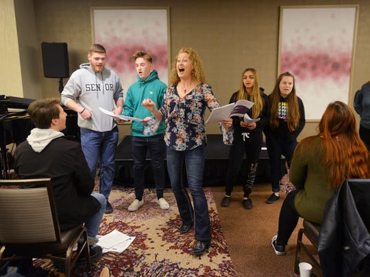 A day before performing at Carnegie Hall, about 80 students from the Gulf Coast and Palmetto Ridge High School choirs rehearsing and doing a private clinic with Heather Buchanan (center), professor of music, director of choral activities at Montclair State University, at Westin in Times Square in New York on Sunday, April 8, 2018.