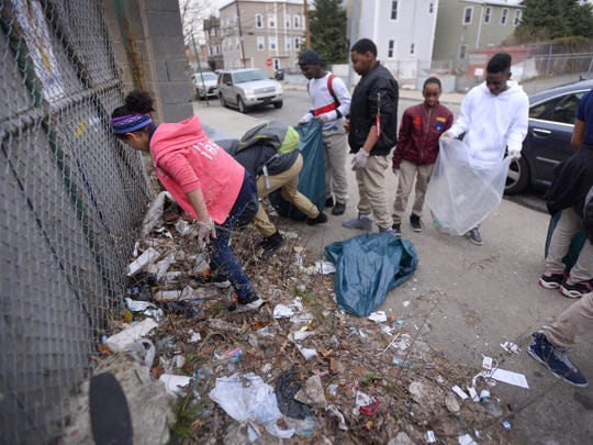 Students of School 10 in Paterson including 6th grader Vielka Marte (in pink) cleans the streets around the outside of their school during the Mayor's New Student Ambassador Program  in Paterson on 4/12/18.