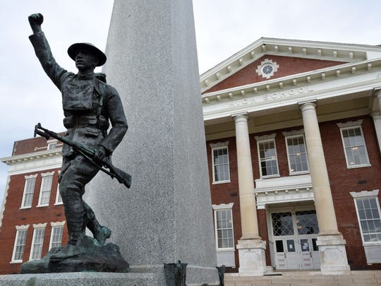 The familiar Doughboy statue stands in front of the old Knoxville High building, now Knoxville High Independent Senior Living.
