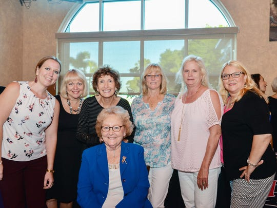 Jennifer Wiggins. Sydney Leibman, Jackie Holfelder, Sandee Allen and Janie Reed pass off the diamond Jewelia necklace to Pat Alley at the Beauty and Wellness Bash to Benefit HANDS Clinic.