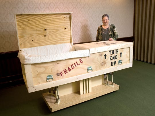 Retired missionary Pat Stooksbury shows her custom-built casket Tuesday, Dec. 16, 2014, at Stevens Mortuary. Stooksbury ordered the casket that looks like a shipping crate because she spent 36 years as a missionary and did a lot of shipping of supplies.