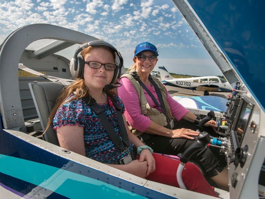 Christina Cash gets ready to take to the sky with pilot
