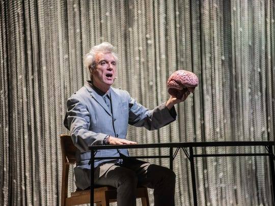 David Byrne and friend kick off his sold-out concert at Milwaukee's Riverside Theater on May 15, 2018.