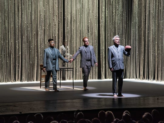 """David Byrne is joined by other singers and performers onstage during the opening number, """"Here,"""" at Byrne's sold-out concert at Milwaukee's Riverside Theater on May 15, 2018."""