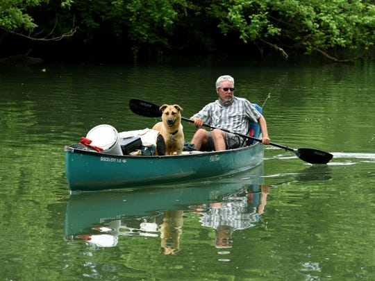Kim Trevathan, Maryville College professor and writer, and his dog Maggie ended their 652-mile and 58-day canoe journey up the Tennessee River Thursday, May 17, 2018 at the Holston River Park.