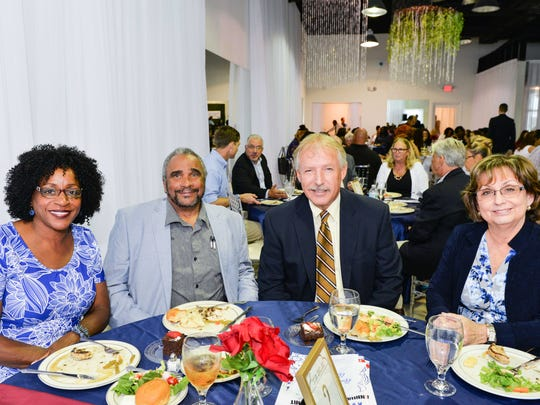Donna Mills, left, Rev. Kenny Mills, Howard Tipton and Karen Knapp at the annual Awards Dinner for the Children's Services Council of St. Lucie County.